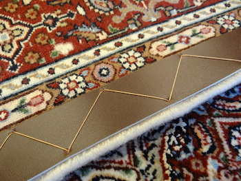 Edges of reinforcements on the back of an oriental carpet