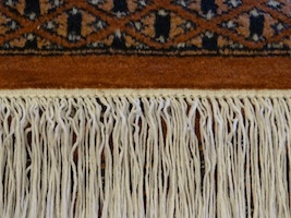 After repair of the fringes on an oriental carpet