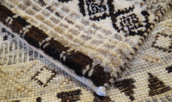 Removal of fringes on an oriental carpet
